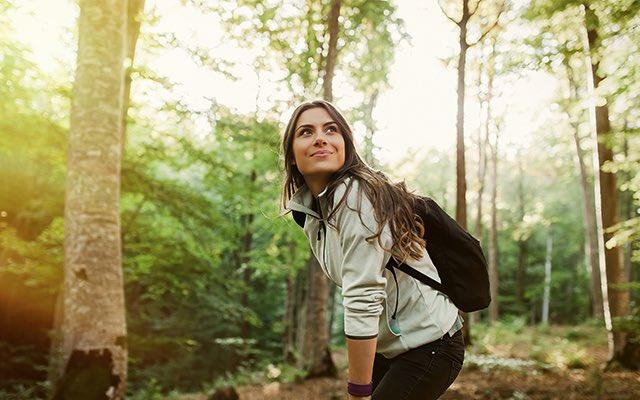 Photo of a woman hiking in the forest