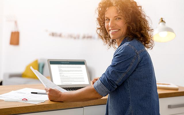 Photo of a smiling middle aged woman at a desk