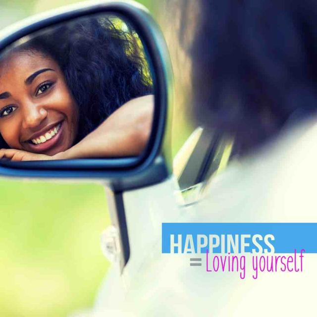 "Photo of a young black woman looking at herself in a car side view mirror with text saying ""Happiness = Loving Yourself"""